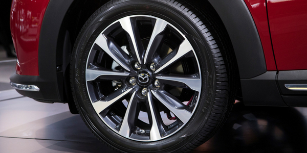 2019 Mazda CX-3 close-up view of wheel with red exterior
