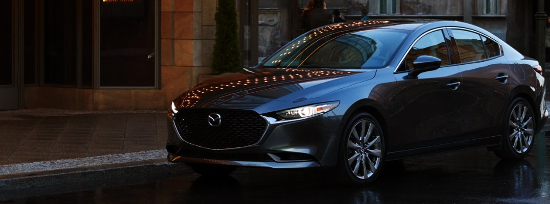 Profile view of 2019 Mazda3 sedan parked on rainy road