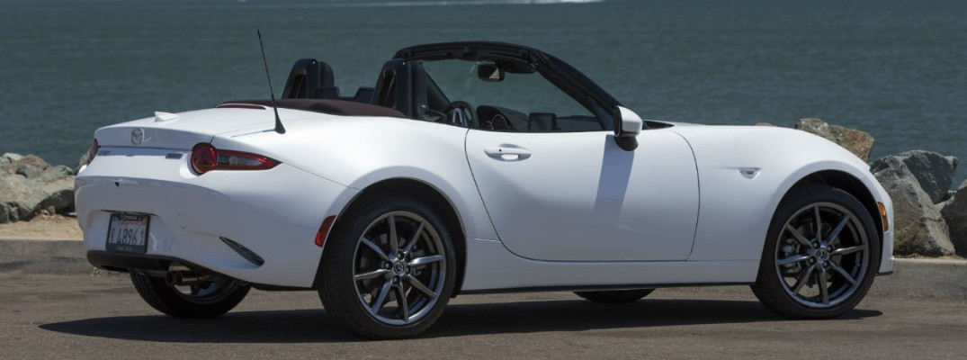 Profile view of white 2019 Mazda MX-5 Miata parked on waterfront lot