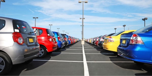 Rows of colorful cars in car lot