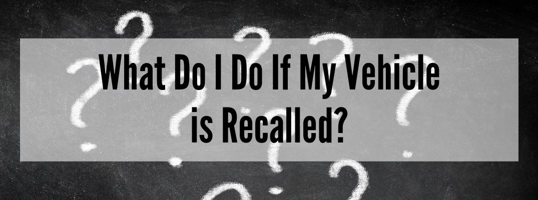 "White question marks on chalkboard with ""What Do I Do If My Vehicle is Recalled?"" white text"