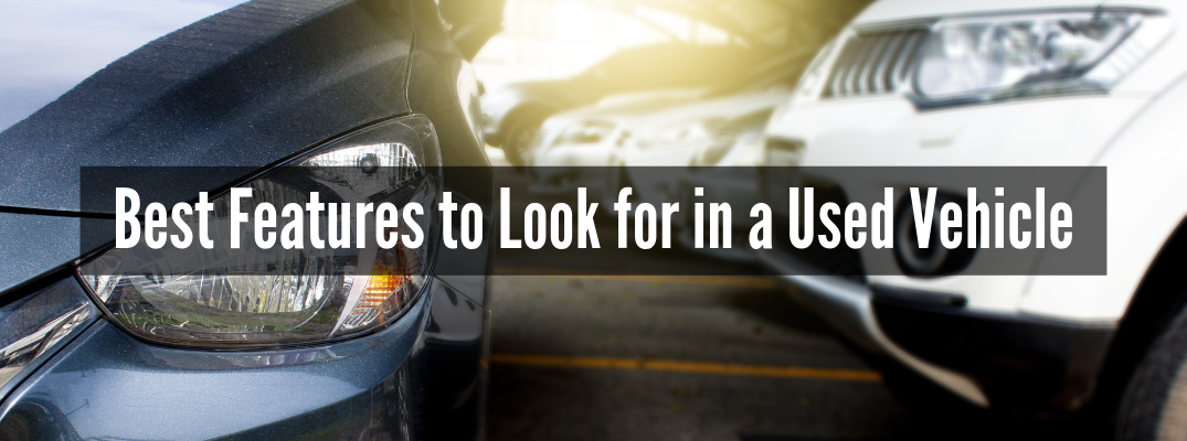 "Closeup of vehicle headlights with ""Best Features to Look for in a Used Vehicle"" white text"