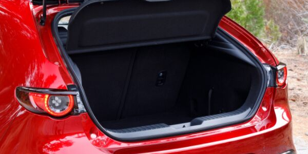 Closeup of open trunk on red 2019 Mazda3 Hatchback