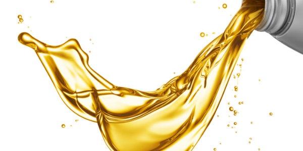 Bottle pouring yellow oil