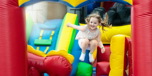 Girl bouncing on indoor bounce house track