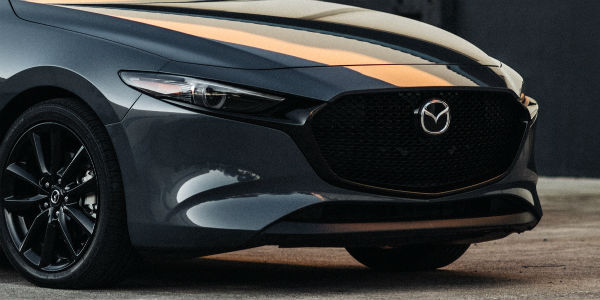 Closeup of grille on grey 2020 Mazda3