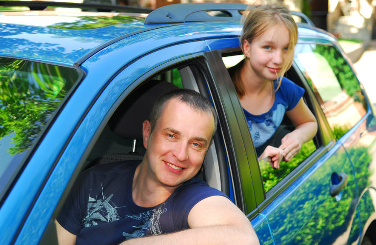 man and girl in blue car