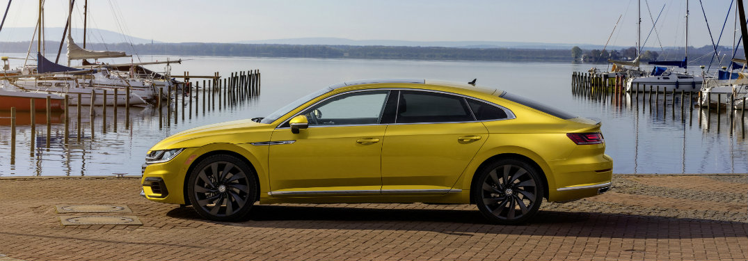 left side of yellow volkswagen arteon