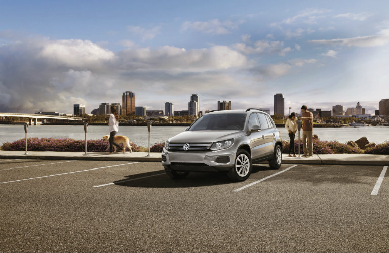 white volkswagen tiguan limited in parking stall