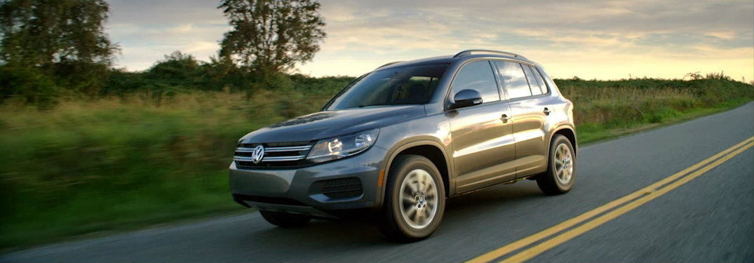 gray volkswagen tiguan limited on rural road