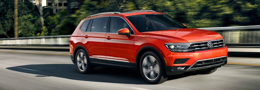 2018 Volkswagen Tiguan driving down the street