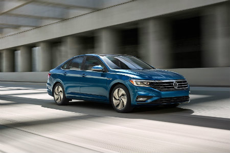 2018 Volkswagen Jetta driving down a highway
