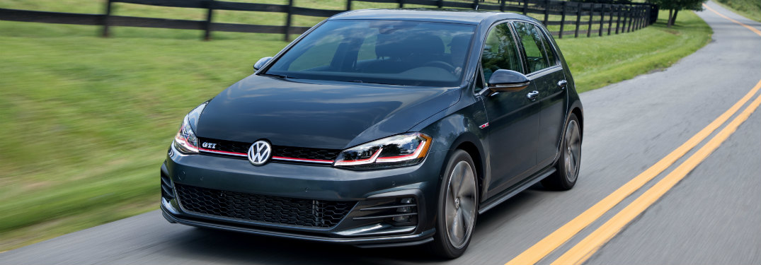 2018 Volkswagen Golf GTI driving down a country road