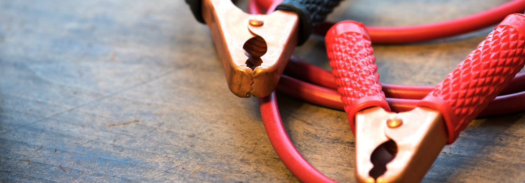 Close-up shot of jumper cables resting on a table
