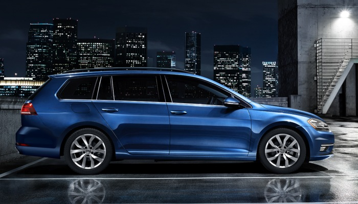 2019 Volkswagen Golf SportWagen parked in a parking lot at night