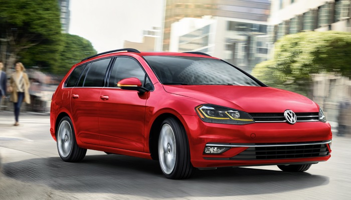 2019 Volkswagen Golf SportWagen driving down a city street