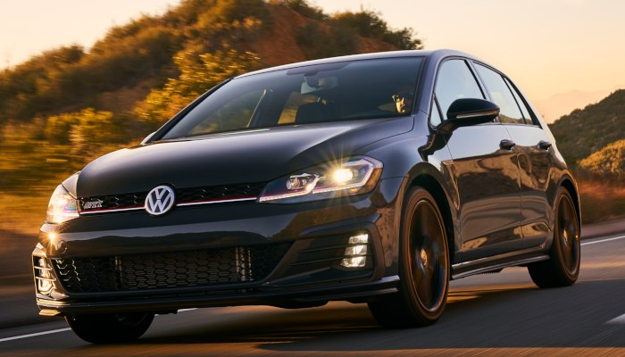 2019 Volkswagen Golf GTI driving down a road at dawn