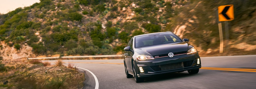 2019 Volkswagen Golf GTI driving down a curving road