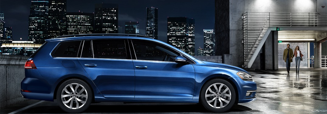 2019 blue Volkswagen Golf SportWagen with city background