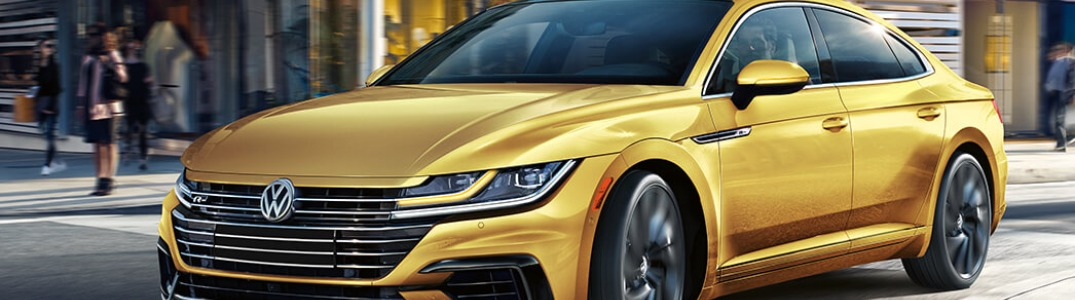 2019 Volkswagen Arteon driving down a city street