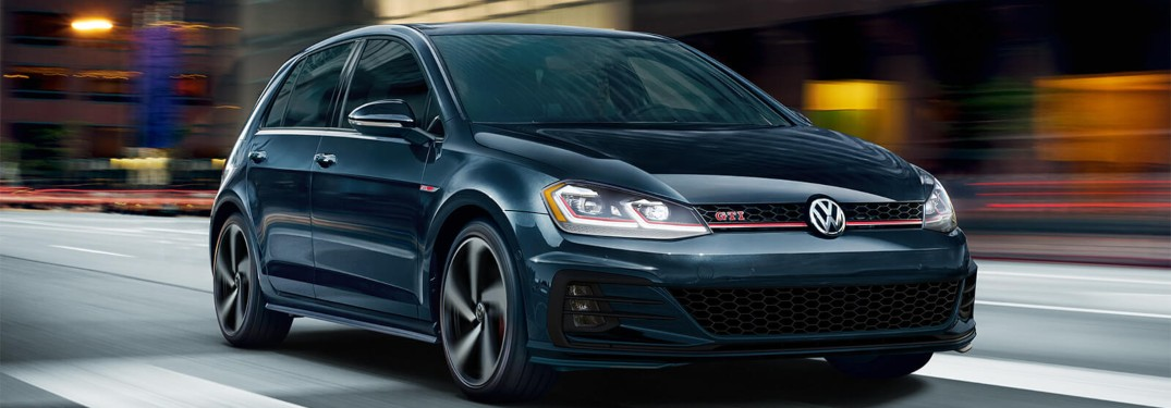 2019 Volkswagen Golf GTI driving down a city street