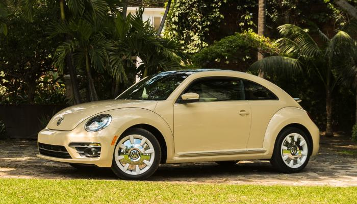 2019 Volkswagen Beetle Final Edition SEL parked in front of a row of trees
