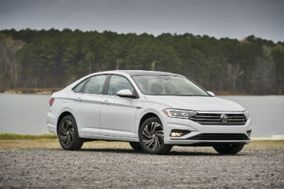 2019 VW Jetta exterior passenger side front fascia parked by lake