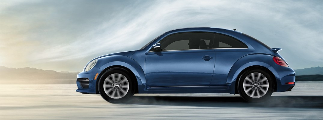 2019 Volkswagen Beetle driving in desert painted blue with cloud contour