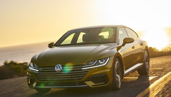 2019 Volkswagen Arteon driving down a road at night
