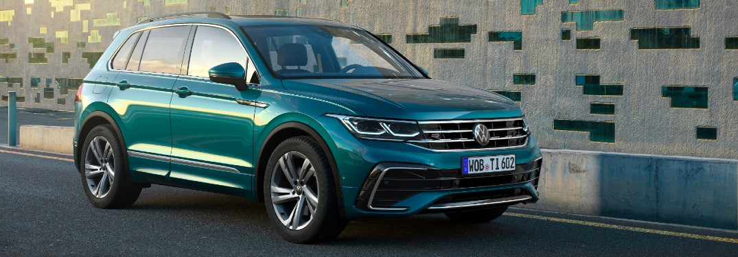 A front and side view of a teal 2022 Volkswagen Tiguan.