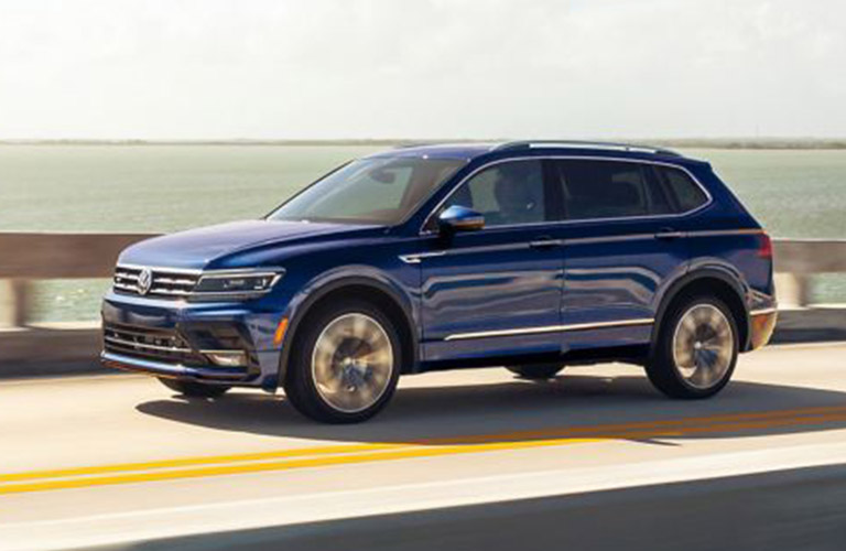 The side view of a blue 2021 Volkswagen Tiguan.