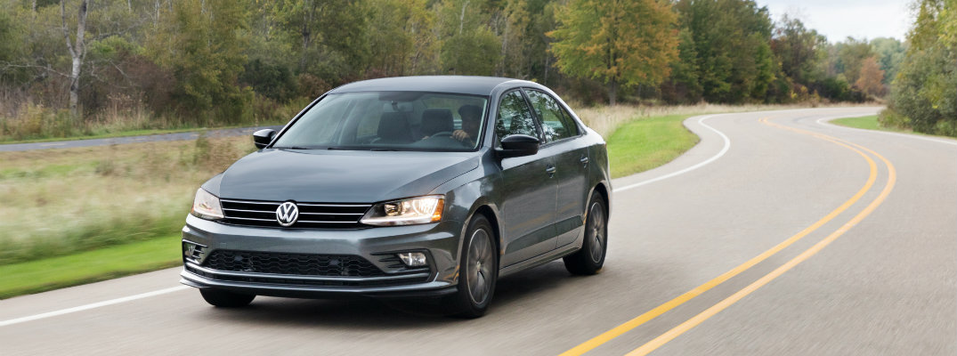2018 Volkswagen Jetta driving surrounded by trees