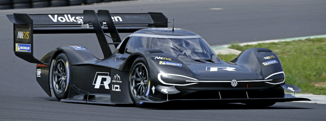Volkswagen I.D. R Pikes Peak electric race car concept parked on the race track near grass and tire walls
