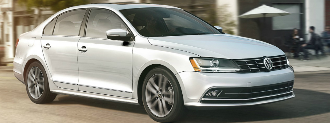 White 2018 VW Jetta Driving on a City Street