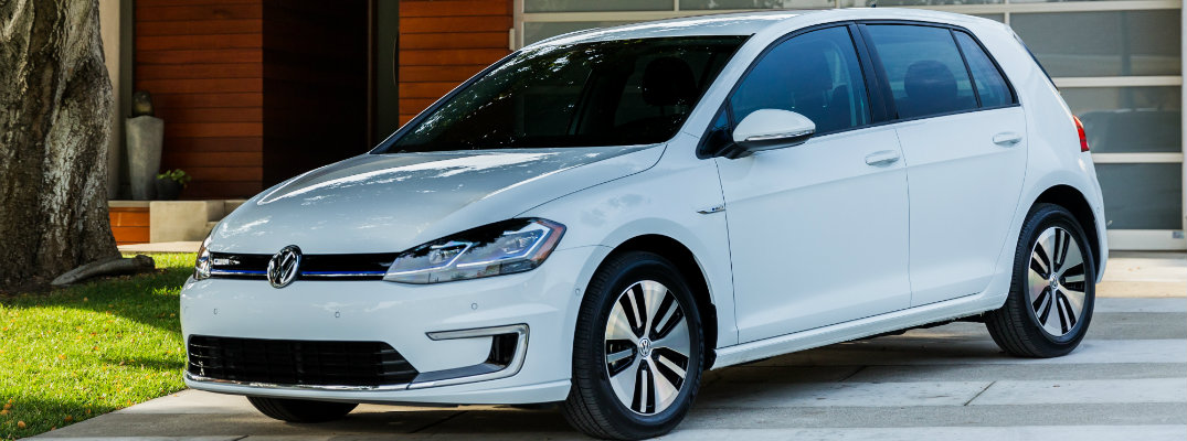 2018 Volkswagen e-Golf exterior shot parked on driveway in front of garage and under the shade of a tree