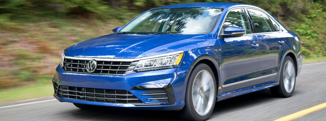2018 Volkswagen Passat R-Line package blue paint color exterior shot driving down a forest road