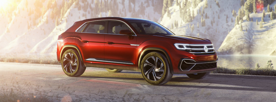 Volkswagen Atlas Cross Sport compact SUV concept exterior side shot parked on a snowy road with sunrise flares in the background