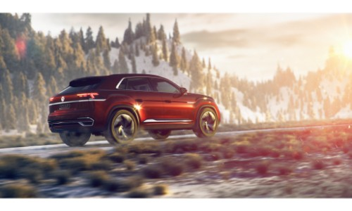 Volkswagen Atlas Cross Sport Concept SUV new york international auto show exterior far away side back shot in the snow with sun flares