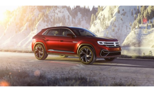 Volkswagen Atlas Cross Sport Concept SUV new york international auto show exterior side shot driving on a snowy road with glare from a sunrise
