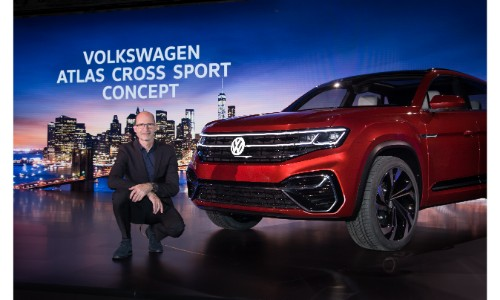 Volkswagen Atlas Cross Sport Concept SUV new york international auto show with presenter kneeling next to model on stage