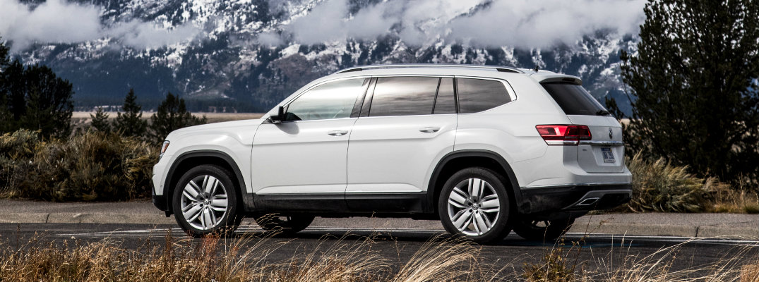 2018 Volkswagen Atlas white parked in wilderness with a snowy mountain in the background