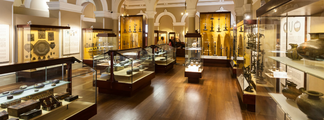 National Museum interior displays of art, artifacts, and vases in glass display cases
