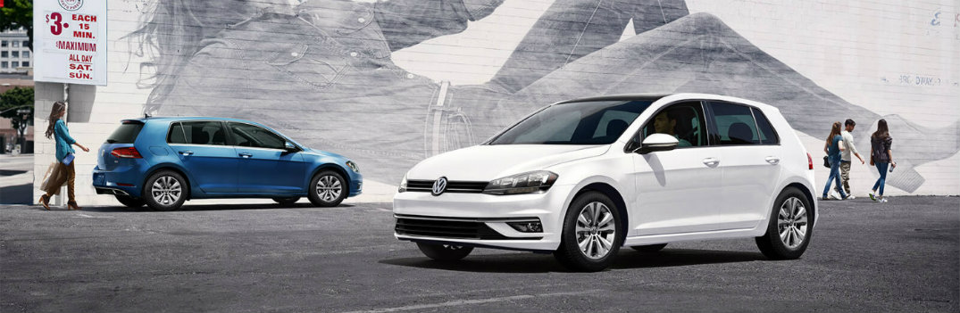 2019 Volkswagen Golf models white and blue exterior shot parked in front of a brick wall covered with graffiti