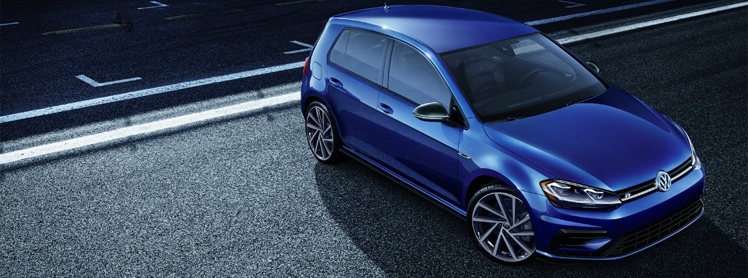 2019 Volkswagen Golf R exterior overhead shot with blue pearl paint color parked on a road at night