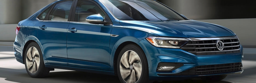 2019 Volkswagen Jetta driving down the road