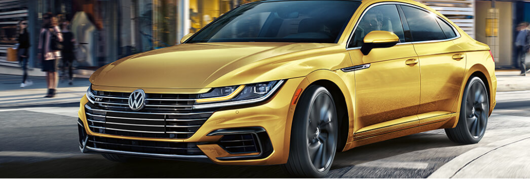 2019 Volkswagen Arteon in yellow driving on road