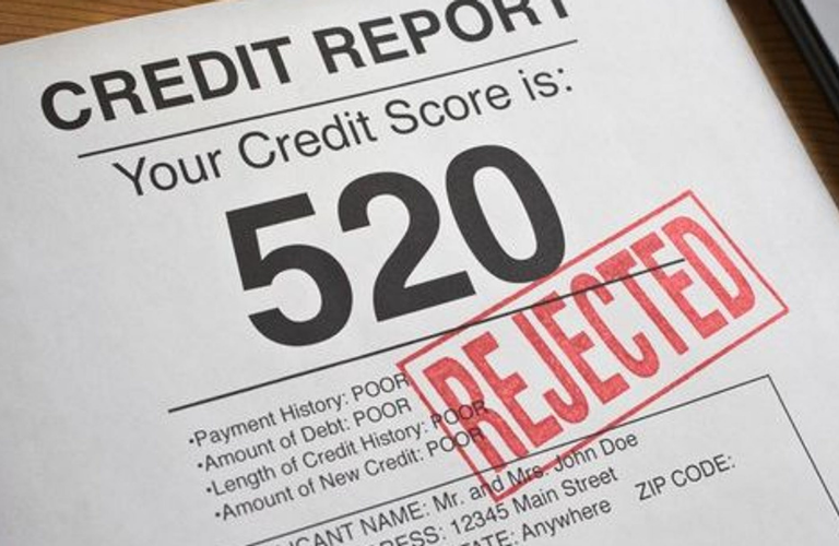 Credit report and loan application that reads rejected