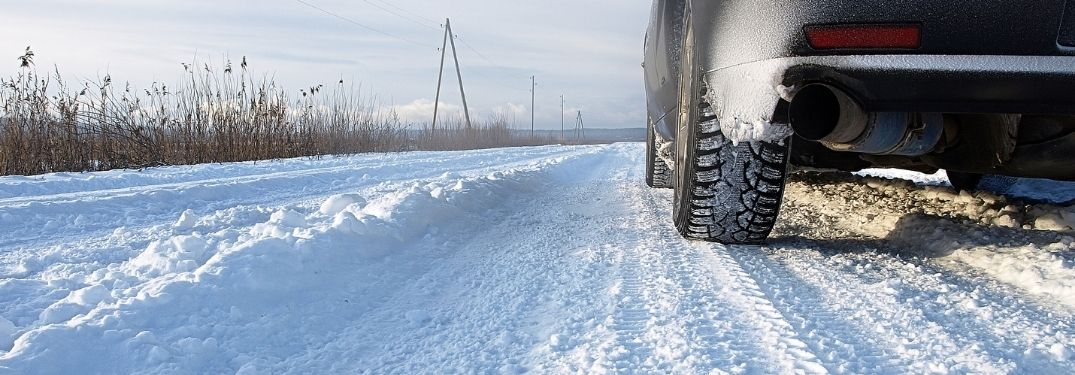 Vehicle driving on a snow covered road
