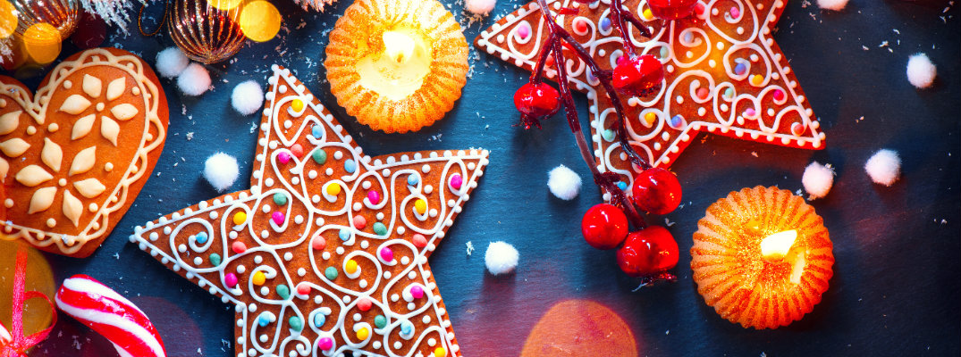 Image featuring highly-decorated holiday cookies and other treats