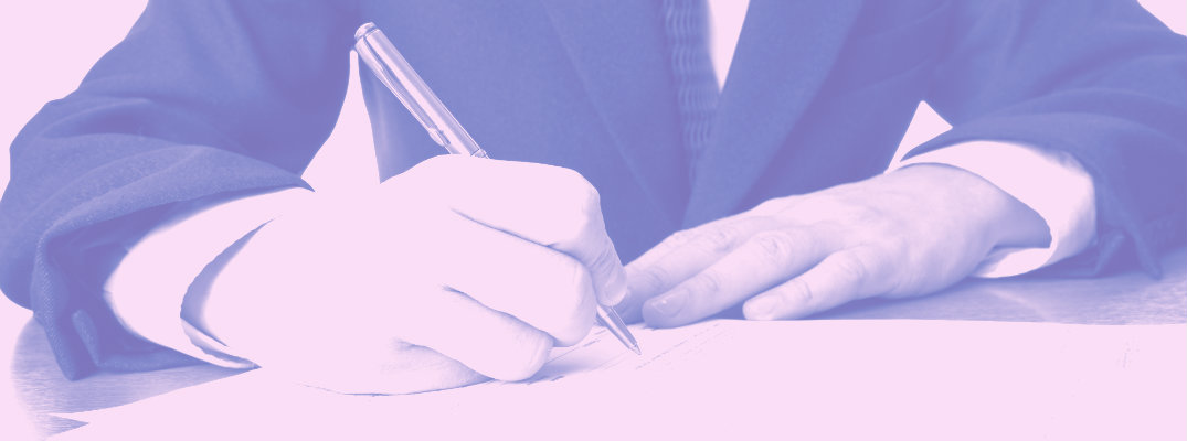 Purple-tinted image of someone signing a document